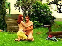 Attractive redhead girl gets...