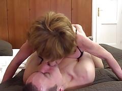 Grandma teaching young boy how 2...