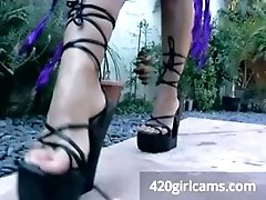 Purple bikini gives foot and tug...