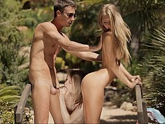 Two sweet petite blondes share a...