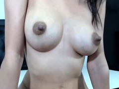 Busty curly brunette with big...
