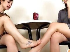 Two barefoot lesbians playing...