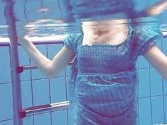 Sexy tight teen Marusia swims...